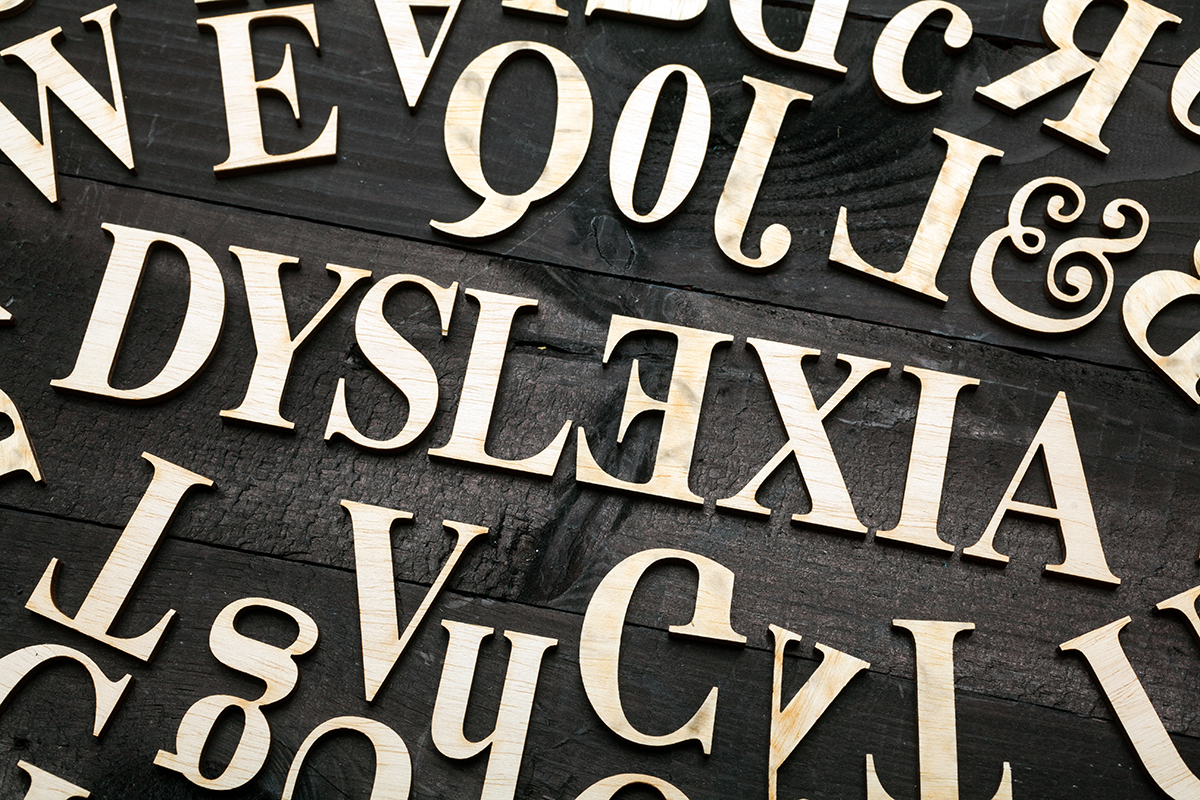 ''Dyslexia'' word with wooden letters on dark background