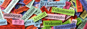 Strips of colored paper with the word Welcome in different languages