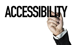 Male hand writing the word accessibility