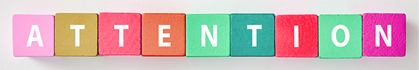 Colorful blocks spelling out the word attention