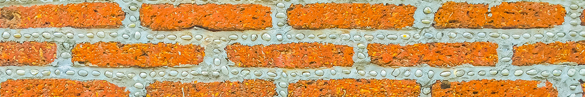 Brick wall displaying dash pattern of bricks